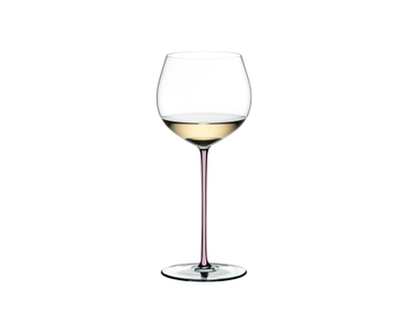 RIEDEL Fatto A Mano Oaked Chardonnay Pink R.Q. filled with a drink on a white background