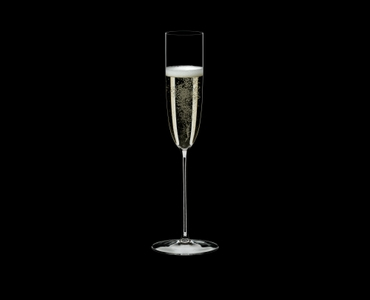 RIEDEL Superleggero Champagne Flute filled with a drink on a black background