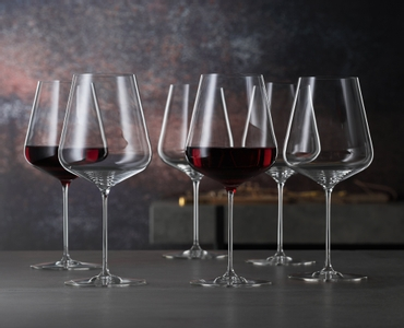 6 unfilled SPIEGELAU Definition Bordeaux Glasses stand slightly offset side by side on white background
