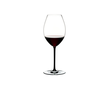 RIEDEL Fatto A Mano Syrah Black R.Q. filled with a drink on a white background