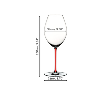 A red wine filled RIEDEL Fatto A Mano Syrah red glass with a red stem on a white background.