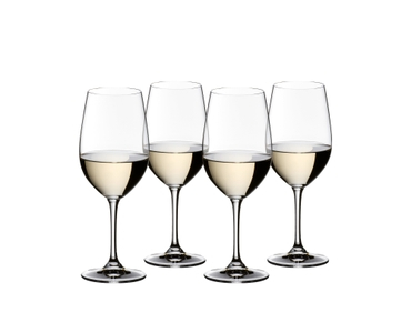 4 RIEDEL Vinum Riesling/Zinfandel glasses filled with white wine stand slightly offset side by side on white background