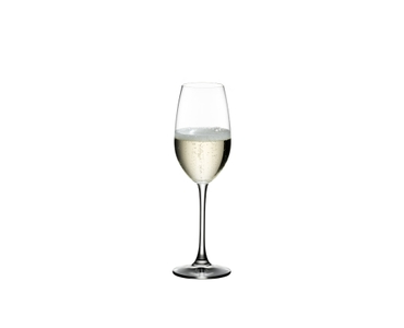 RIEDEL Ouverture Champagne Glass filled with a drink on a white background