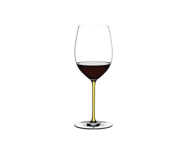 RIEDEL Fatto A Mano Cabernet/Merlot Yellow filled with a drink on a white background