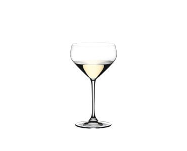 RIEDEL Extreme Junmai filled with a drink on a white background