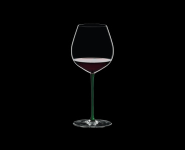 RIEDEL Fatto A Mano Pinot Noir Green filled with a drink on a black background