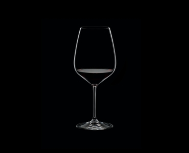 RIEDEL Extreme Restaurant Cabernet filled with a drink on a black background