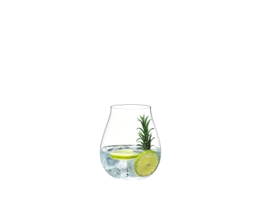 A decorated gin cocktail served in a RIEDEL O Wine Tumbler Gin Glass. Another RIEDEL Gin Glass holds striped straws. The glasses stand on a wooden table.