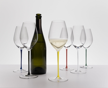 A RIEDEL Fatto A Mano Champagne Wine Glass with red stem filled with red wine on a white background.
