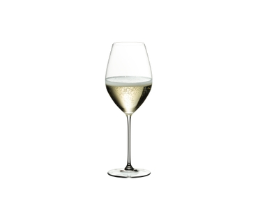 RIEDEL Veritas Champagne Wine Glass filled with a drink on a white background