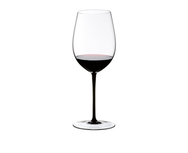 A RIEDEL Sommeliers Black Tie Bordeaux Grand Cru filled with red wine on white background