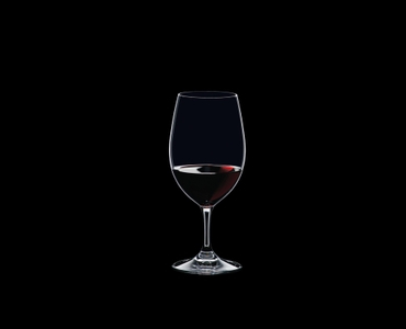 RIEDEL Ouverture Restaurant Magnum filled with a drink on a black background