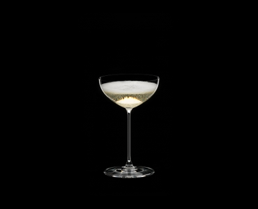 RIEDEL Veritas Restaurant Coupe/Cocktail filled with a drink on a black background