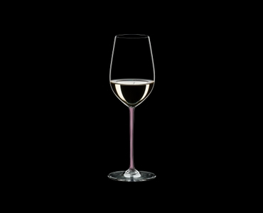RIEDEL Fatto A Mano Riesling/Zinfandel Pink R.Q. filled with a drink on a black background