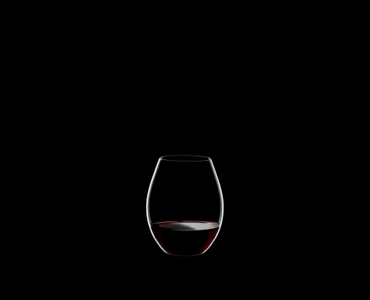 RIEDEL Degustazione O filled with a drink on a black background