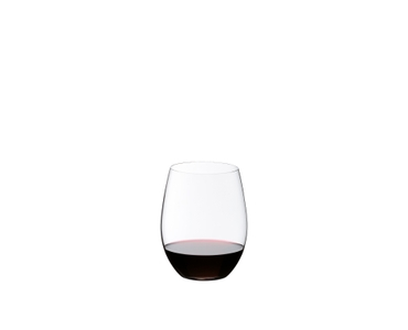 2 O Wine Tumbler Cabernet filled with red wine stand on a garden table. Grissini sticks, cheese and grapes lie next to them.