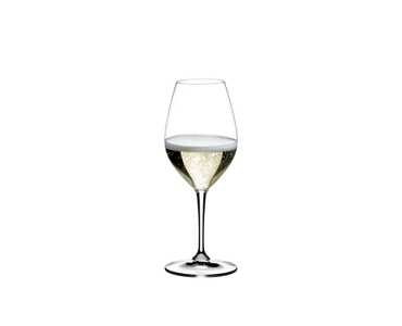RIEDEL Restaurant Champagne Wine Glass filled with a drink on a white background