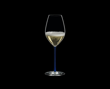 RIEDEL Fatto A Mano Champagne Wine Glass Dark Blue filled with a drink on a black background