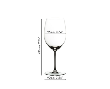 A RIEDEL Veritas Cabernet/Merlot glass on a white background filled with red wine