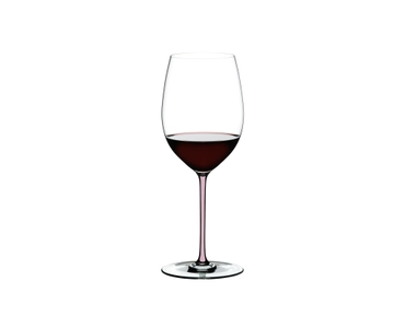 RIEDEL Fatto A Mano R.Q. Cabernet Pink filled with a drink on a white background