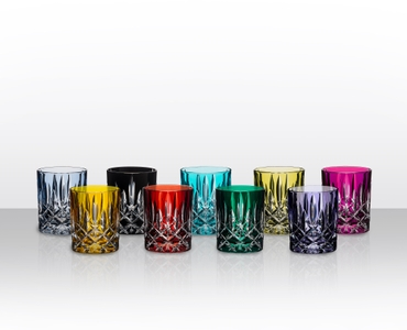 9 RIEDEL Laudon tumblers in various colors (f.l.t.r.: light blue, amber, black, red, turquoise, dark green, light green, violet and pink) stand slightly offset side by side
