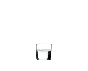 RIEDEL Bar Water filled with a drink on a white background