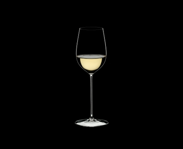 RIEDEL Superleggero Viognier/Chardonnay filled with a drink on a black background