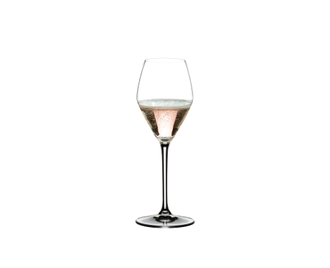 Blonde lady in a white blouse holds a RIEDEL Extreme Rosé Wine / Rosé Champagne Glass filled with Rosé Wine.