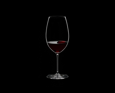 RIEDEL Veritas Restaurant New World Shiraz filled with a drink on a black background