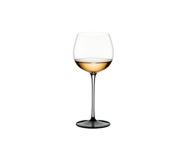 RIEDEL Sommeliers Black Tie Montrachet filled with a drink on a white background