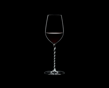 RIEDEL Fatto A Mano Riesling/Zinfandel Black & White R.Q. filled with a drink on a black background