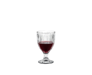 RIEDEL Tumbler Collection Fire All Purpose Glass filled with a drink on a white background