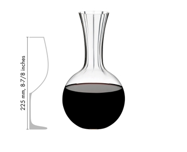 RIEDEL Decanter Performance Magnum filled with a drink on a white background