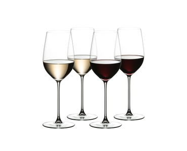 4 RIEDEL Veritas Riesling/Zinfandel glasses stand slightly offset next to each other. Two are filled with white wine the other two are filled with red wine.