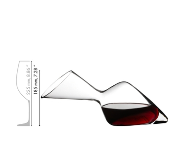 Woman sits on a table with a red wine filled RIEDEL Winwings Cabernet glass and a RIEDEL Altitude Matters Decanter.