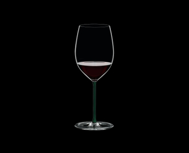RIEDEL Fatto A Mano R.Q. Cabernet/Merlot Green filled with a drink on a black background