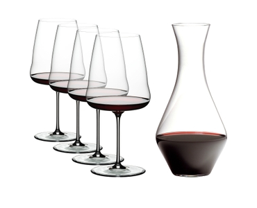 4 RIEDEL Winewings Cabernet Sauvignon glasses and 1 Cabernet Magnum Decanter filled with red wine on white background