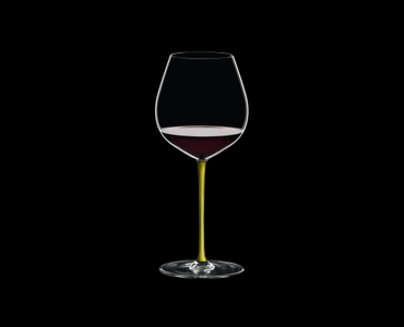 RIEDEL Fatto A Mano Pinot Noir Yellow filled with a drink on a black background