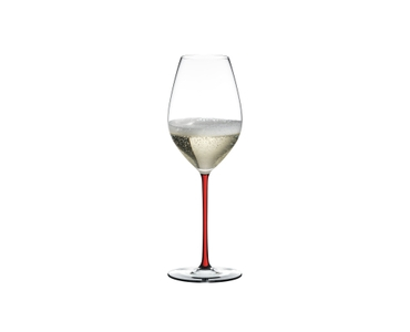 A RIEDEL Fatto A Mano Champagne Wine Glass with red stem filled with red wine.