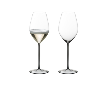 A Champagne filled and an unfilled RIEDEL Superleggero Champagne Wine Glass stand side by side on white background