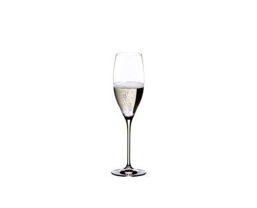 Two RIEDEL Vinum Cuvée Prestige glasses filled with sparkling wine stand side by side on white background