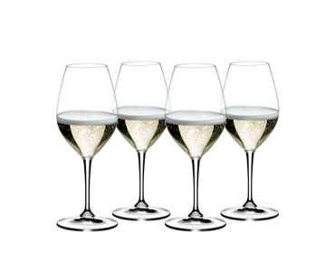 4 RIEDEL Vinum Champagne Wine Glassed filled with champagne stand slightly offset side by side on a white background