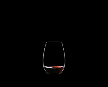 RIEDEL O Wine Tumbler Syrah/Shiraz filled with a drink on a black background