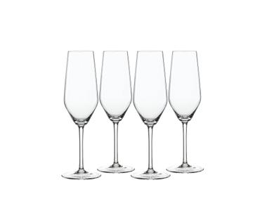 4 empty SPIEGELAU Style Champagne Flutes on white background