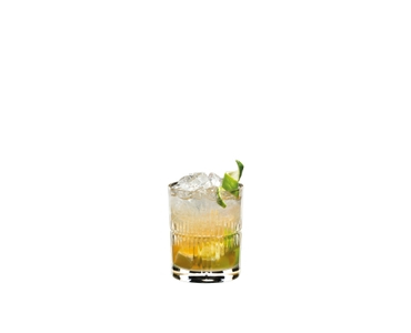 RIEDEL Mixing Rum Set filled with a drink on a white background