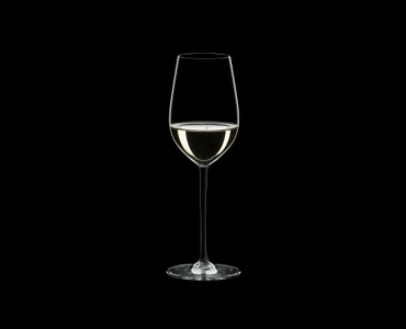 RIEDEL Fatto A Mano Riesling/Zinfandel Black R.Q. filled with a drink on a black background
