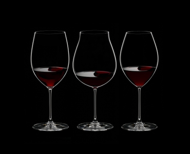 RIEDEL Veritas Red Wine Tasting Set filled with a drink on a black background