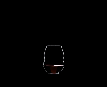 RIEDEL Swirl Red Wine filled with a drink on a black background