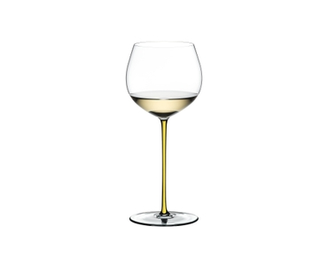 RIEDEL Fatto A Mano Oaked Chardonnay Yellow filled with a drink on a white background
