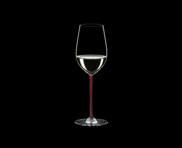 RIEDEL Fatto A Mano Riesling/Zinfandel Red R.Q. filled with a drink on a black background